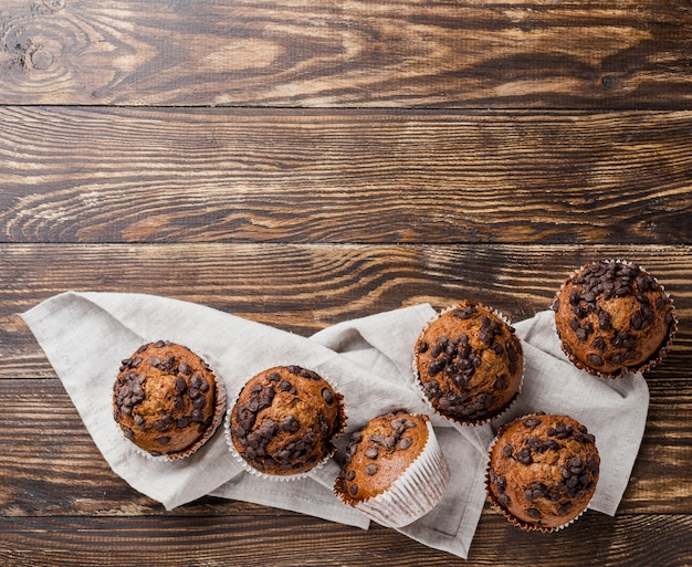 Delicious top view muffins on cloth