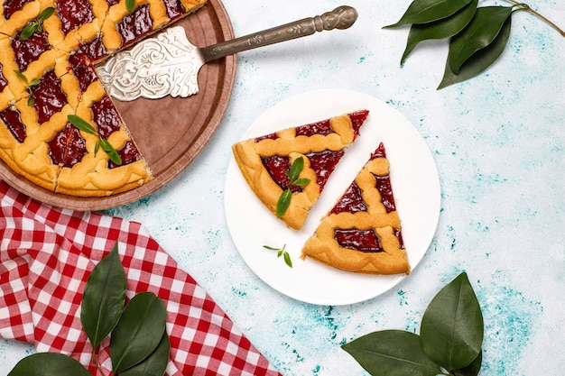 Delicious traditional berry cherry pie crostata on light surface