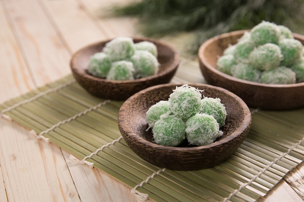 Delicious traditional indonesian sweet rice balls stuffed with palm sugar