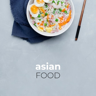 Delicious typical asian rice on gray background