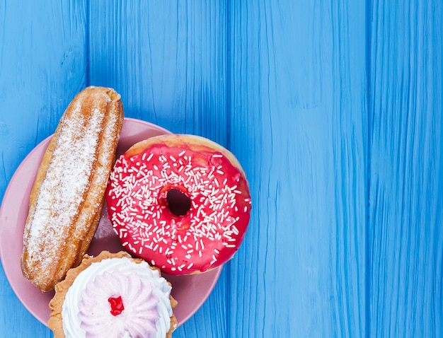 Delicious unhealthy snack on wooden background