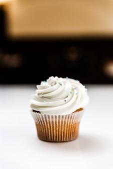 A delicious vanilla cupcake with cream