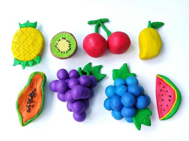 Delicious variety fruits plasticine clay, colorful cherry grapes blueberry watermelon shap