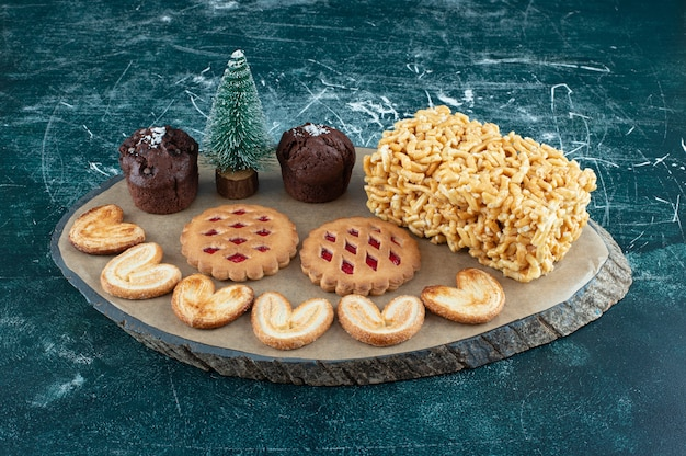 Delicious various pastries on a wooden board. high quality photo
