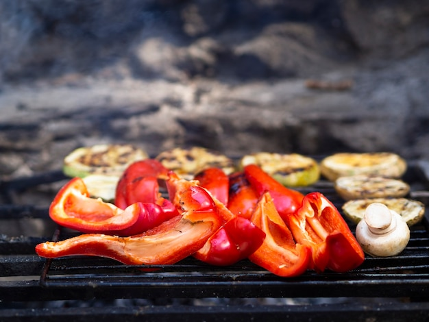 Delicious vegetables cooking on grill