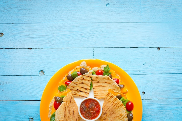 Delicious veggie quesadillas with tomatoes, olives, saã²ad and cheddar