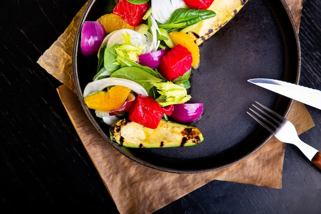 Delicious warm grilled vegetables salad with avocado in restaurant