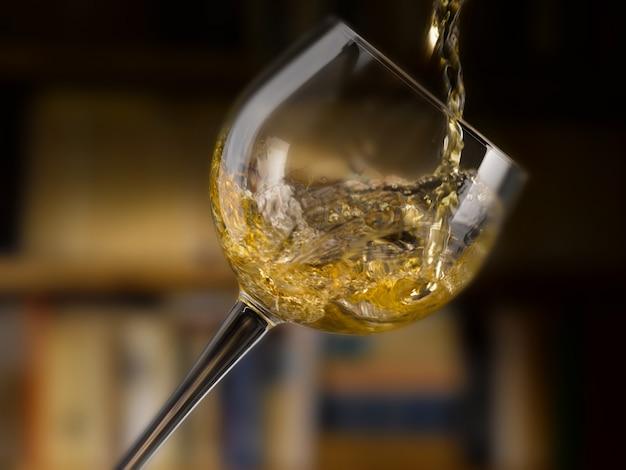Delicious white wine poured into a glass