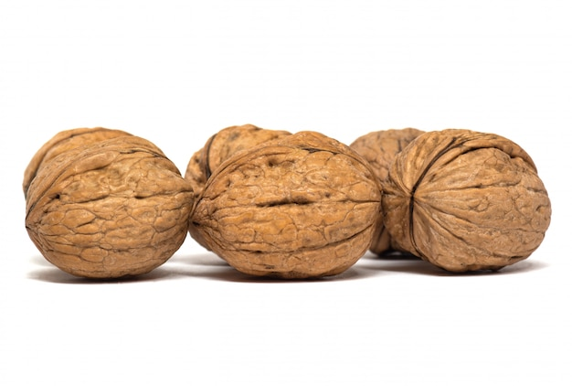 Delicious whole walnuts isolated on a white background