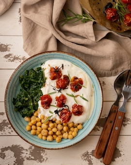 Delicious yougurt meal with chickpeas and dried tomatoes