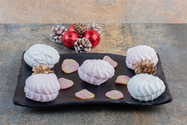 Delicious zephyrs with jelly candies and pinecones . high quality photo