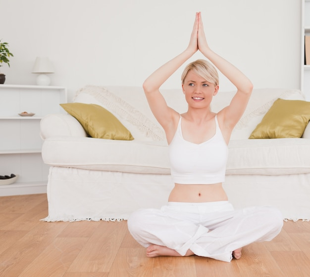 Delighted blondhaired woman practicing yoga