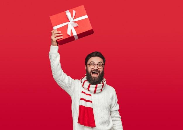 Delighted man demonstrating christmas gift