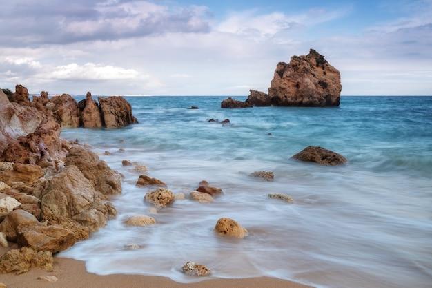 A delightful landscape on a rocky beach arrifes im albufeira.