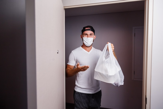 Deliver man holding plastic bag with food