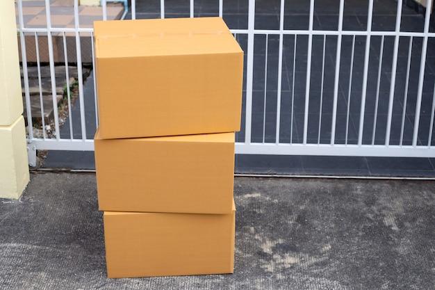 Delivered parcels on floor front house