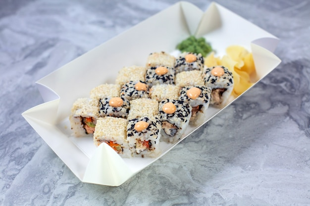 Delivered set of sushi in paper eco container