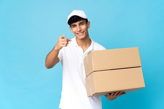 Delivery argentinian man isolated pointing front with happy expression