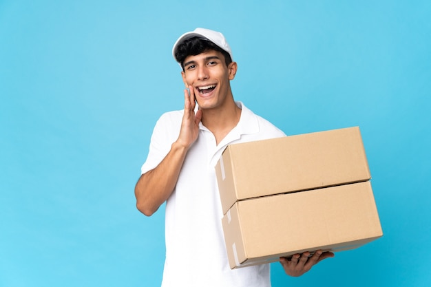 Delivery argentinian man isolated shouting with mouth wide open