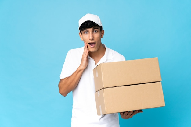 Delivery argentinian man isolated with surprise and shocked facial expression