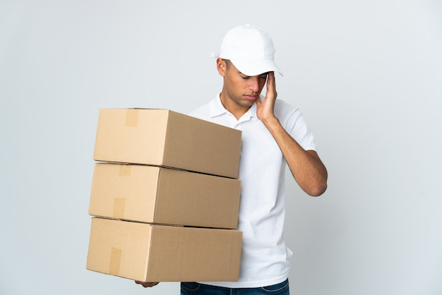 Delivery brazilian man isolated on white wall with headache