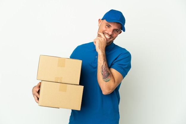 Delivery caucasian man isolated on happy and smiling