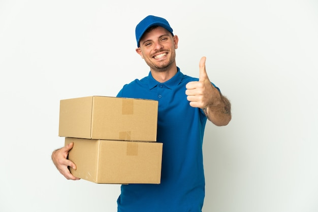 Delivery caucasian man isolated on white background with thumbs up
