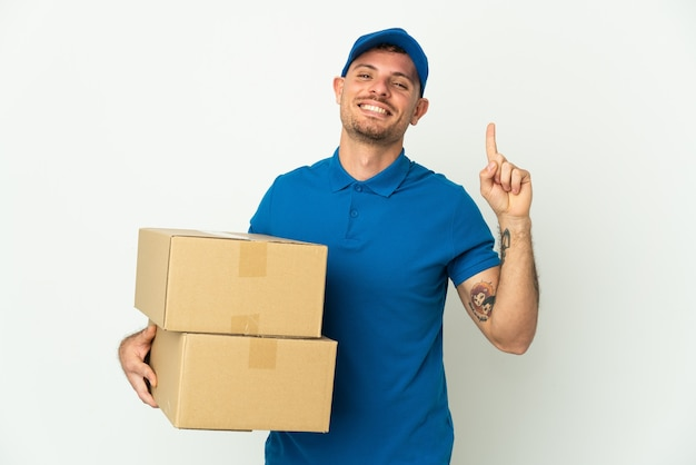 Delivery caucasian man isolated on white showing and lifting a finger in sign of the best