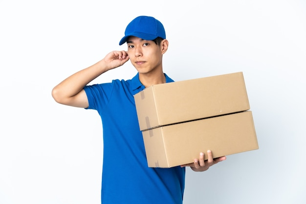 Delivery chinese man on white having doubts
