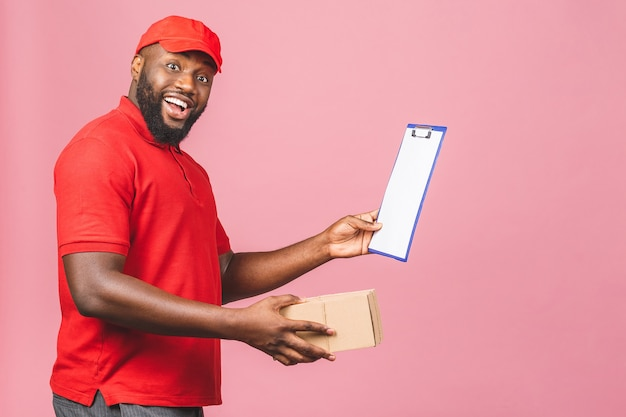 Delivery concept. african american delivery man carrying parcel and presenting receiving form