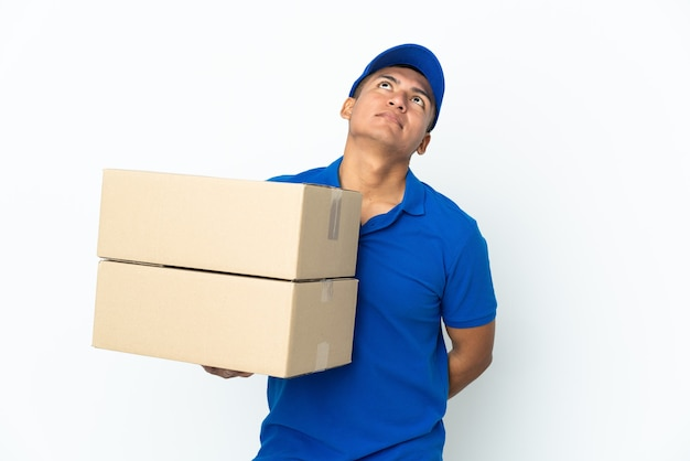 Delivery ecuadorian man isolated and looking up