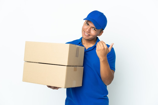 Delivery ecuadorian man isolated on white background inviting to come with hand. happy that you came