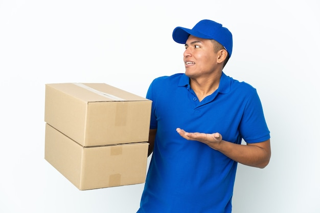 Delivery ecuadorian man isolated on white background with surprise expression while looking side