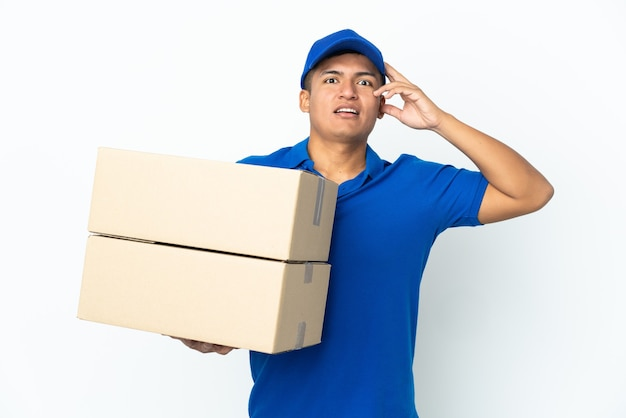 Delivery ecuadorian man isolated on white background with surprise expression