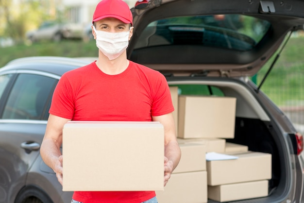 Delivery guy wearing mask front view