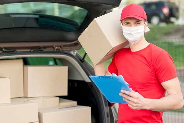Delivery guy wearing mask and hat