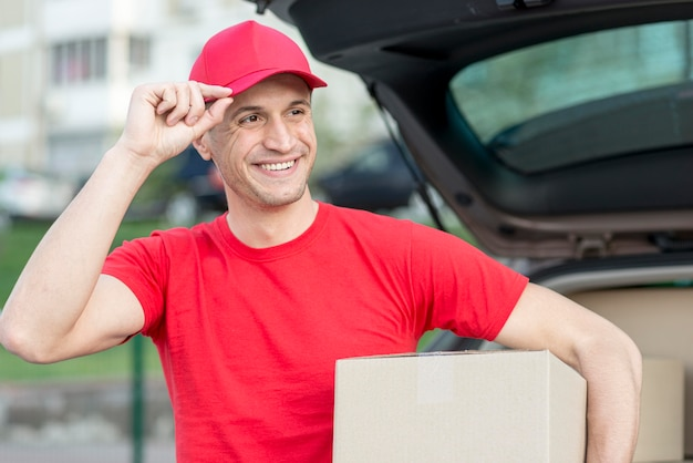 Delivery guy with hat smiling