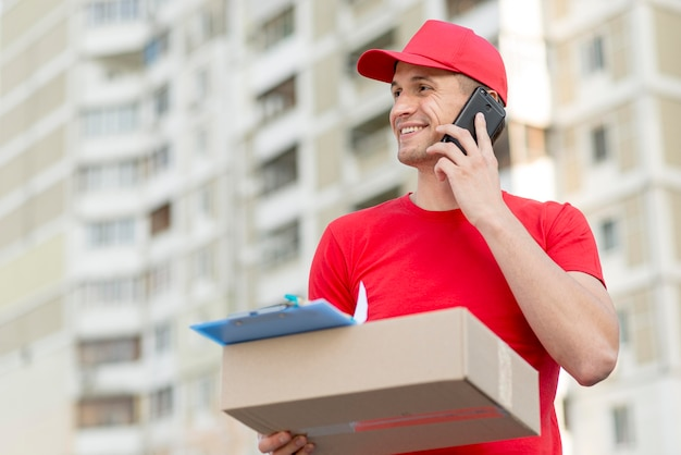 Delivery guy with smartphone