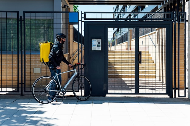 Delivery man on bicycle arriving home