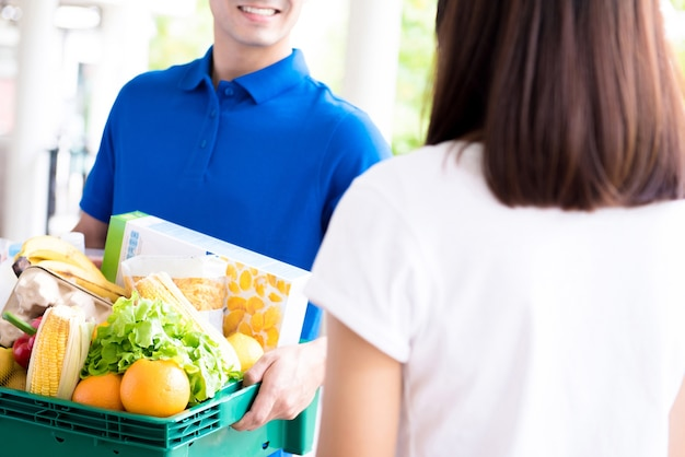 Delivery man delivering food to a woman