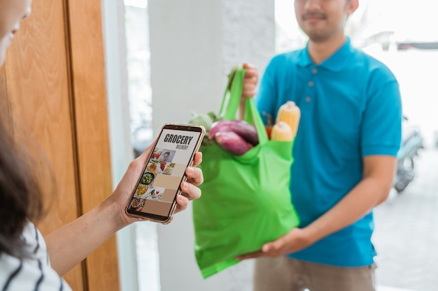 Delivery man delivering groceries