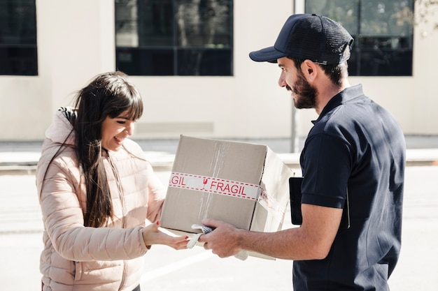Delivery man delivering parcel to female customer