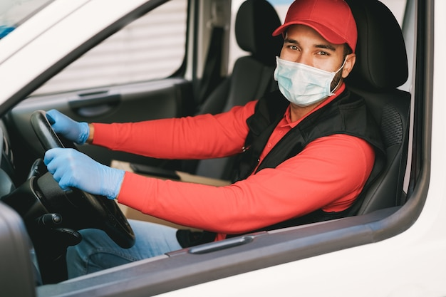 Delivery man driving a van during coronavirus outbreak
