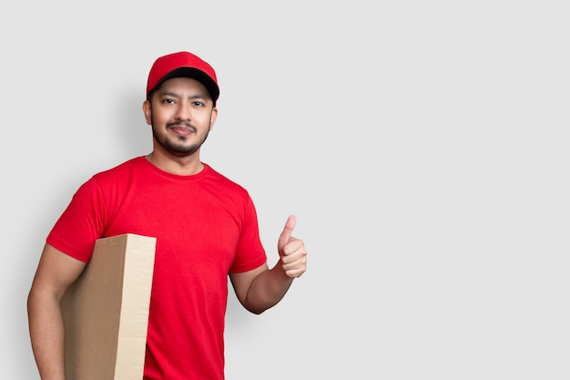Delivery man employee in red cap and finger uniform