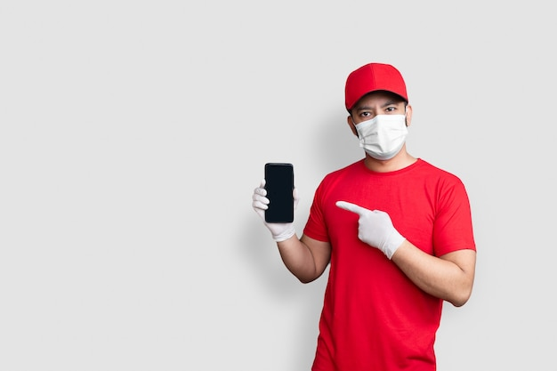 Delivery man employee in red cap and uniform