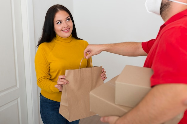 Delivery man giving a woman her new purchase