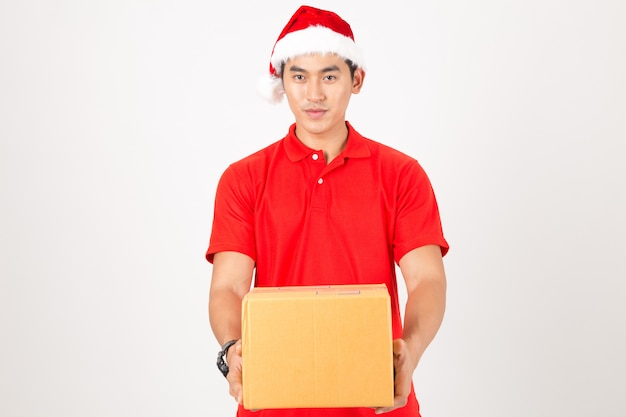 Delivery man holding boxes during christmas. isolated on a white background.