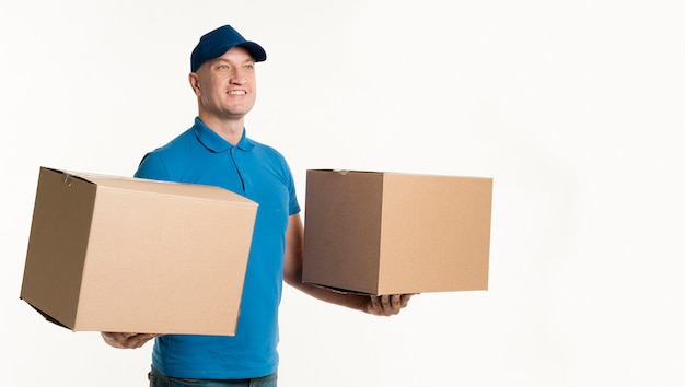 Delivery man holding cardboard boxes in each hand