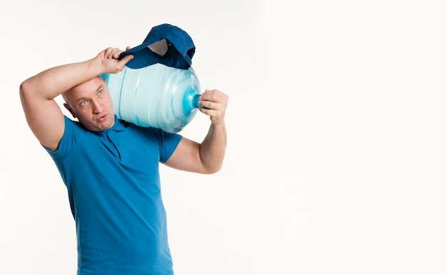 Delivery man holding heavy water bottle