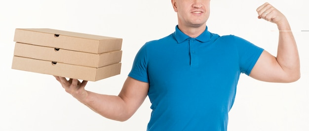 Delivery man holding pizza boxes and showing bicep